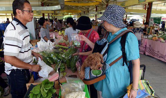 Farmers sell season specials at Hope Plaza Farmer Market in Taipei