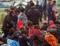 2,000 refugees relocated on first day of major police operation to evacuate Idomeni border camp